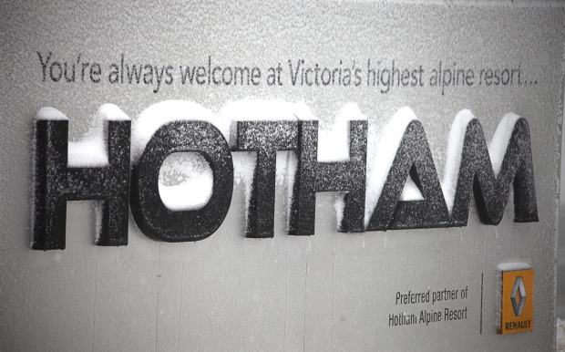 Snowfall covers the sign at Hotham. A further 3cm is expected to fall this weekend.