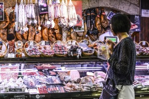 Sausages and ham for sale at La Boqueria Market, Barcelona.