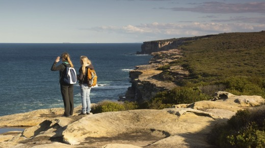 Hikers look towards the sea along the Royal National Park's coastal walk.