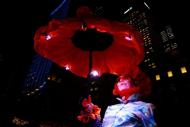 Andrea Davies poses as 'Mrs Monet' during the 'Enchanted Sydney' light show at Customs House.