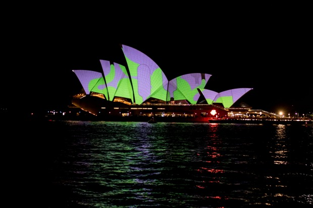 The Sydney Opera House lights up on the opening night.