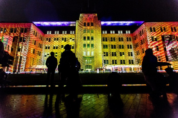 The public look on and interact with the lighting installations around Circular Quay.