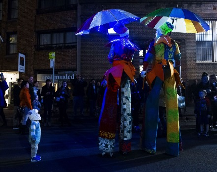 A child is captivated by performers during VIVID light festival.