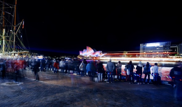 People pack the shore of Circular Quay to experience the lights.