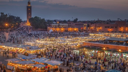 Everyone is out and about in Marrakech's Djemma El Fna Square by night.