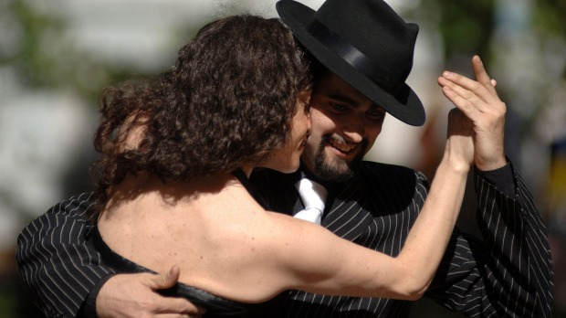 Tango dancers perform in commemoration of Tango Day in downtown Montevideo,
