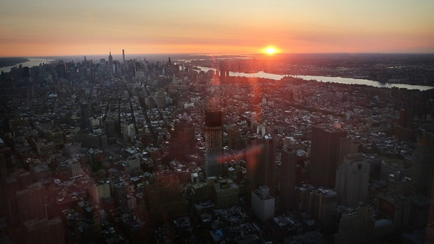 Manhattan is viewed at dawn from the newly built One World Observatory at One World Trade Center on the day it opened to ...