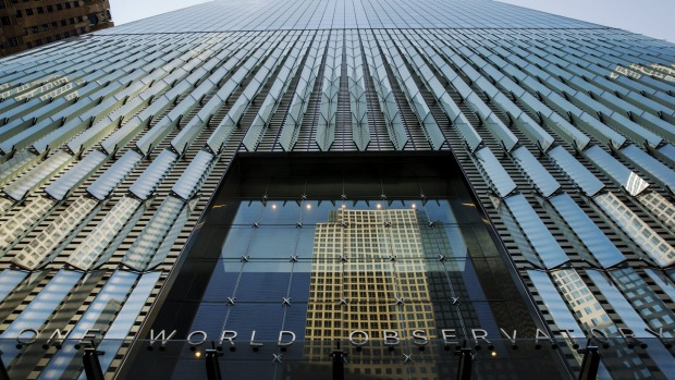 One World Trade rises above the entryway of the newly opened One World Observatory in the Manhattan borough of New York ...