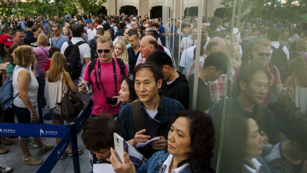 Visitors stand in line as they wait to enter the newly opened One World Observatory in the Manhattan borough of New York ...
