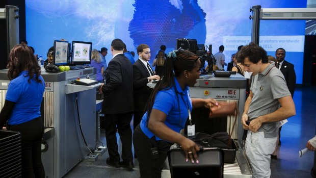 Visitors go through security screening as they enter the newly opened One World Observatory in the Manhattan borough of ...