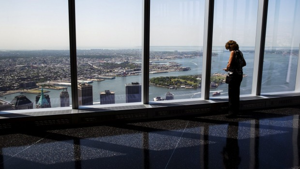 A woman looks out the windows of the newly opened One World Observatory in New York May 29, 2015. Taking up parts of the ...