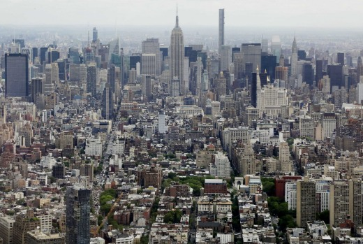 FILE- In this May 20, 2015 file photo, Midtown Manhattan, including the Empire State Building, center, are seen from the ...