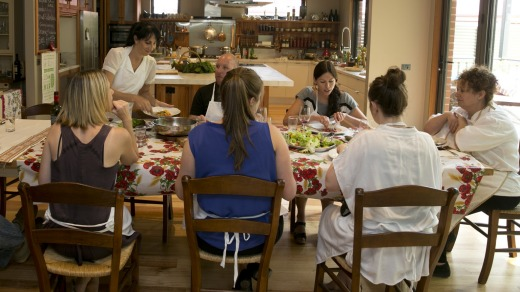 Patrizia Simone's Country Cooking School with Patrizia at head of table on right.