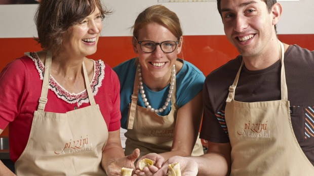 Katrina Pizzini (left) and her cooking school.