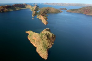 A thrilling helicopter flight over Lake Argyle shows submerged mountains  are now islands.