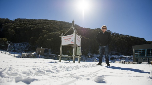 Shop owner in Thredbo and Jindabyne, Reggae Elliss welcomes the snow.