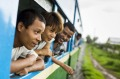Passengers lean out of the windows of the Yangon Circular Train.