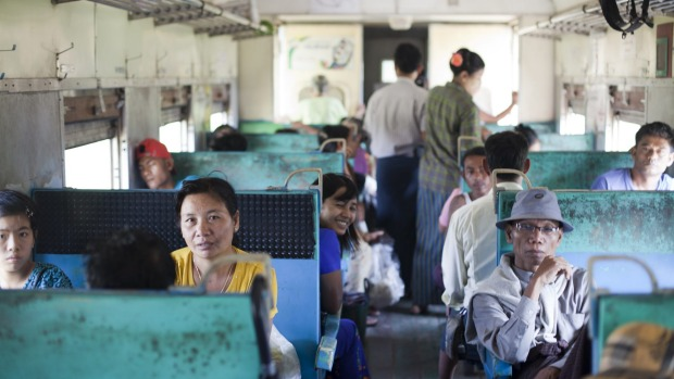 The interior of the Yangon train is hardly luxurious.