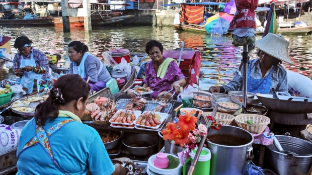 Vendors cook food in their boats at the Amphawa Floating Market in Aphawa, Samut Songkhram Province, Thailand.