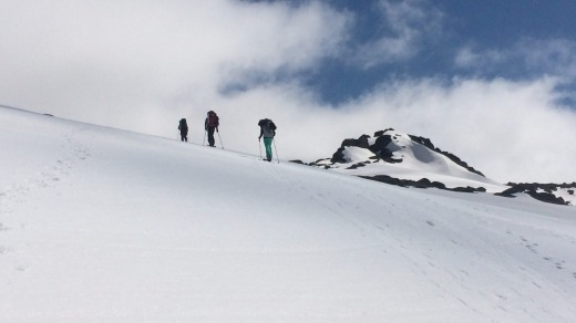 It's not easy going, cross-country skiing uphill in ski boots and wearing heavy backpacks.
