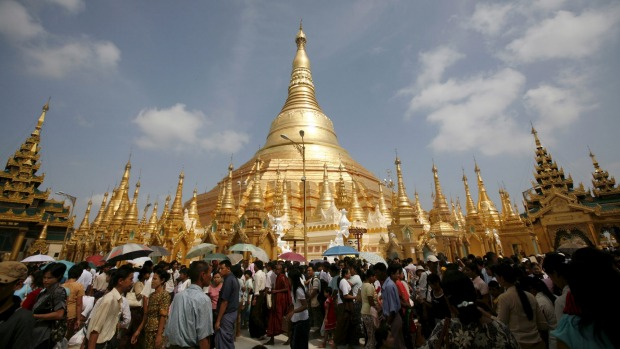 Devotees crowd the Shwedagon Pagoda during the Kason watering festival in Yangon.