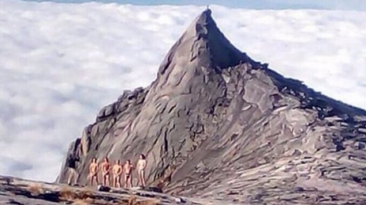 Photos of tourists who stripped on Mt Kinabalu in Malaysian Borneo went viral on social media.