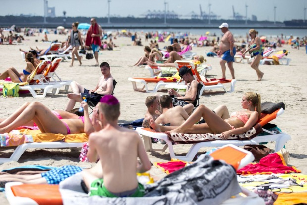 Photo AP People Sunbathe On The Beach In Hoek Van Holland
