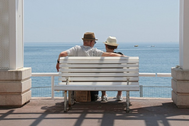 People take a rest on a warm day, on the promenade des Anglais in Nice, southeastern France.