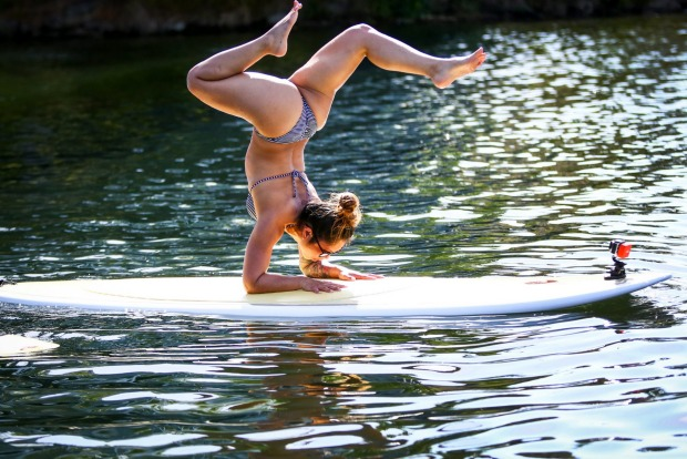 Nina Lascano practices her balance while on a paddle board floating on Lake Union in Seattle.