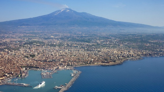 Etna, Sicily, Italy: Coughing ash into the sky within easy reach of some of Sicily's loveliest baroque villages, ...