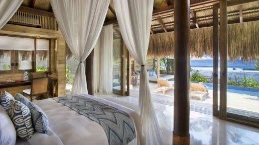 A bedroom with a pool view at the Nihiwatu resort.