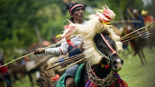 A Sumbanese horseman takes part in the pasola ritual.