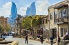 The inner city of Baku with the Flame Towers  in the background.