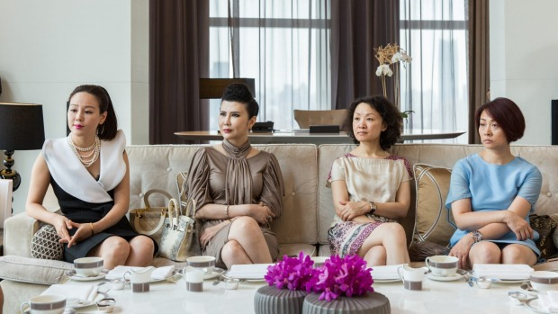 Wealthy Shanghainese matrons learn the fine points of afternoon tea, Western style.