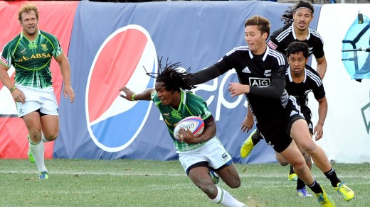 Team South Africa tries to break-away from Team New Zealand during the USA Sevens Rugby Tournament in Las Vegas.