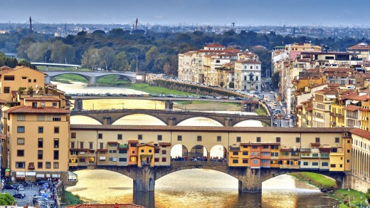 Bridges over the Arno River at sunset in Florence, Italy.