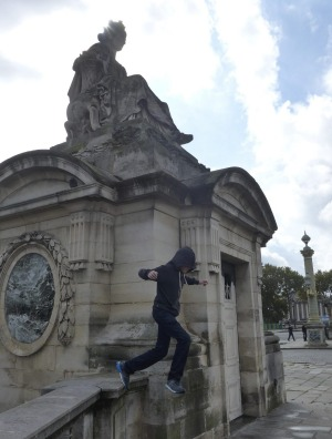 A teenager tries parkour in Paris.