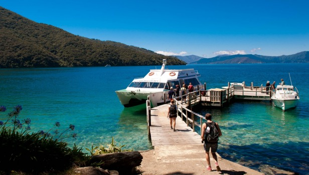 The Magic Mail Boat plies Queen Charlotte Sound six times a week, delivering mail and groceries to households ...