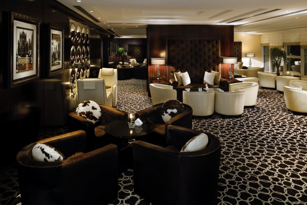Move around to the lounges and it's something else: couples sunken into romance among plush leather sofas while taking ...