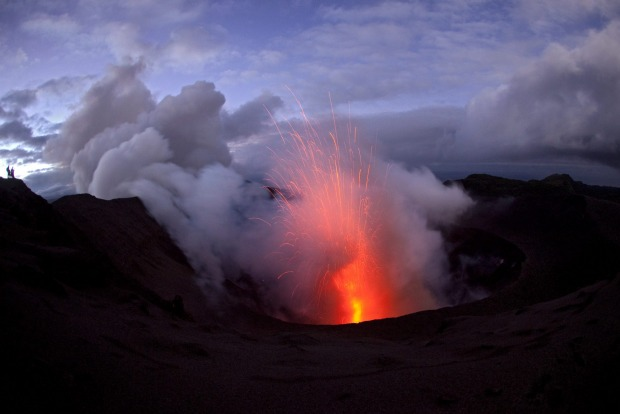 Mount Yasur, Tanna, Vanuatu: From the lush green forests that cloak the lower slopes of the island, a four-wheel drive ...