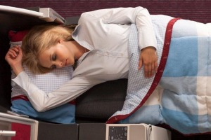 Austrian Airlines business class seat in lie-flat mode.