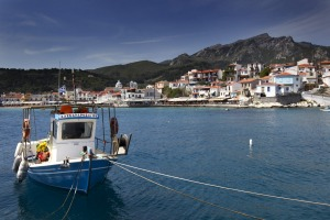 A Greek caique (fishing boat) is  moored in Kokkari bay, on the Greek island of Samos.