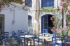 A typical greek restaurant on a sunny day in Vathi the capital of Ithaki, Greece.
