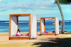There's a <i>Sex and the City</i> vibe at the beach cabanas at Outrigger Mauritius Resort.