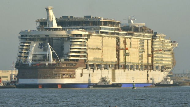 Mammoth in the making ... Cruise liner Harmony of the Seas is towed by tug boats into its new moorings at the STX ...
