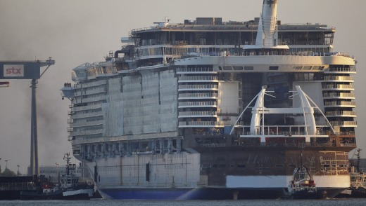 Massive liner in works ... The Harmony of the Seas (Oasis 3) class ship is put into the water at the STX Les Chantiers ...