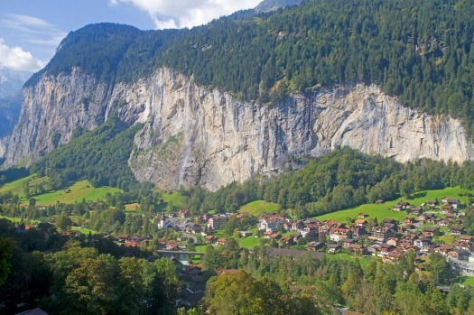 The Swiss town of Lauterbrunnen, with Staubbach Falls tumbling down the cliffs behind