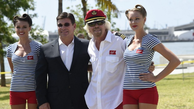 Sir Richard Branson poses for a photo with Virgin Cruise President and CEO Tom McAlAlpin, second from left, at the Perez ...