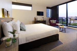 A room with a sweeping view in the Alpha Mosaic Hotel.