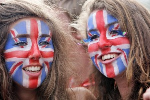 Girls with Union Jack flags face paint in England, UK